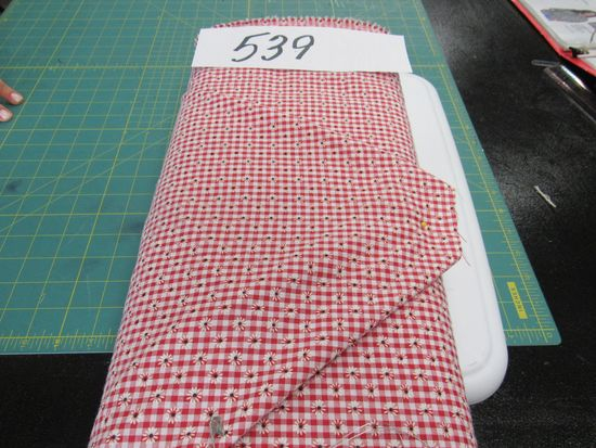 red and white checkered with daisy pattern fabric selling by the yard