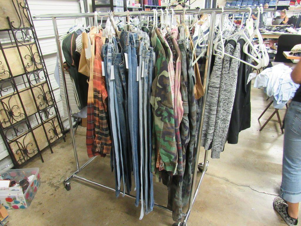 Double Chrome racks on casters 48 inches, expandable.  Clothing shown in picture not included.