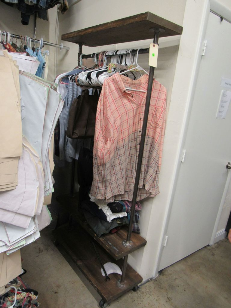 industral style garment rack with wood shelving.  Clothing shown in picture not included.