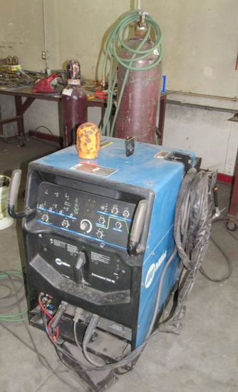 Miller Syncromatic 250-DX liquid cooled TIG welder with leads and bottle