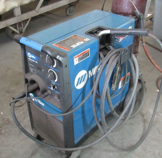 Millermatic 251 MIG welder with stnger and owner tank