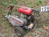 portable gasoline powered magnum pressure washer mounted on cart.  Hoses, and spray gun included