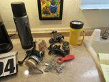 Thermos ss bottle, stringer, reels, flashlight