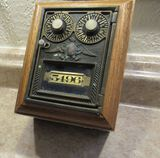 coin bank made from old brass post office box