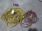 group of 2 extension cords (1) 100' heavy duty yellow, (1) 50' heavy duty orange