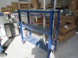 heavy duty blue aluminum shelving unit on casters