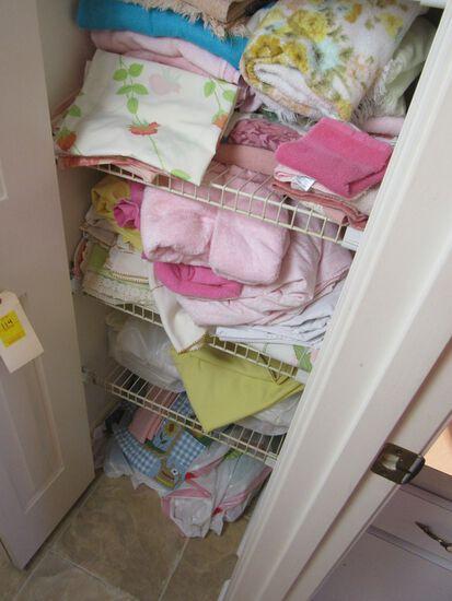 towels, sheets, linens in hall closet