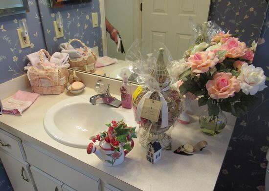 mixed toiletries, vase, and décor in guest bathroom