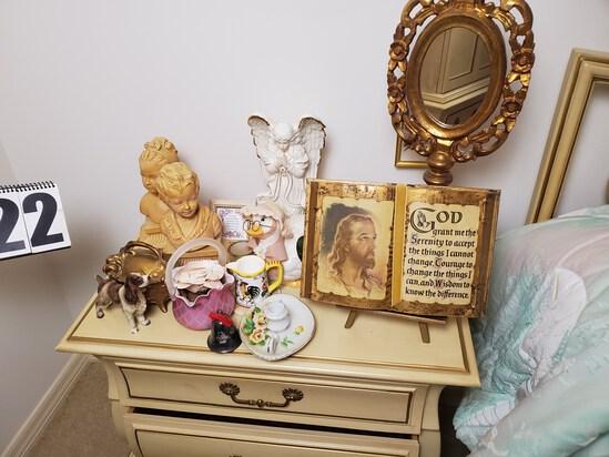mixed bedroom décor including wall décor, ceramic figures