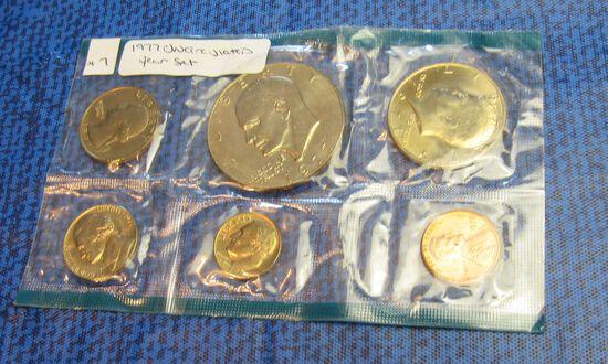 1977 uncirculated US coin set  - Ike dollar, Kennedy 1/2, Washington quarter, Jefferson nickle, Roos