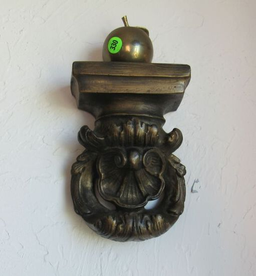 plaster wall figure with brass apple