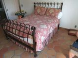 Queen Size wrought iron bed with bedding