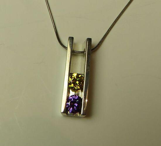 "Sterling pendant w/2 c.z. (dark yellow & purple) on 16"" sterling chain"