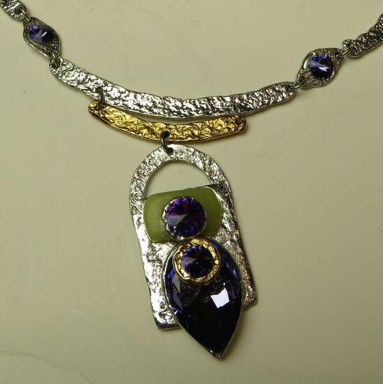 "Silver tone 18"" necklace w/5 purple c.z. stones"
