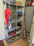 steel utility shelf unit with cleaning supplies 33