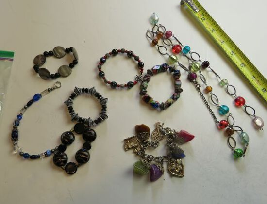 group of 8 mixed necklaces and bracelets