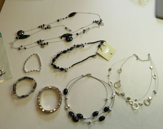 group of 7 mixed bracelets and necklaces