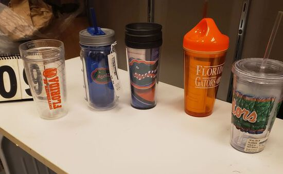 tote of mixed Gator water bottles and tumblers