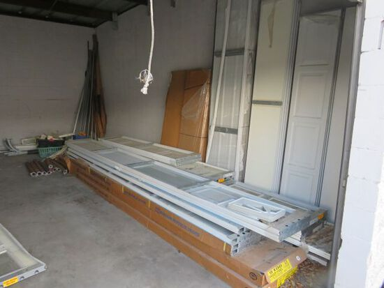 inventory of new residential garage door parts including (8) new Wayne Dalton 16' x 7 with lite mode