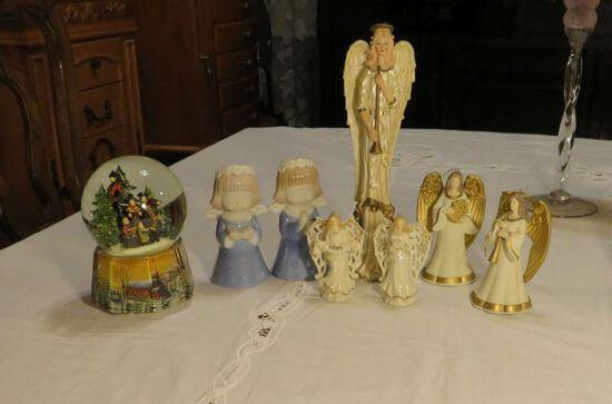 group of Christmas figures and globe