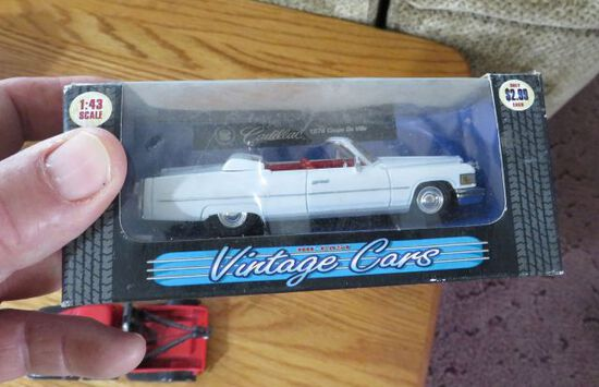 toy automobiles (2 in boxes)