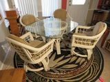 Rattan dinette set with glass top 4 matching chairs