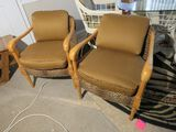wood frame upholstered arm chairs with faux leopard and brown upholstery fabric