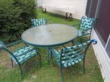 green patio table set with 4 vinyl web strapped patio chairs