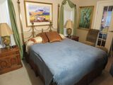 Queen bed with brass finished headboard
