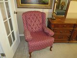 red upholstered wing back chair