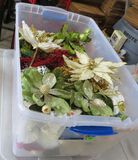 clear plastic storage tote of Christmas florals