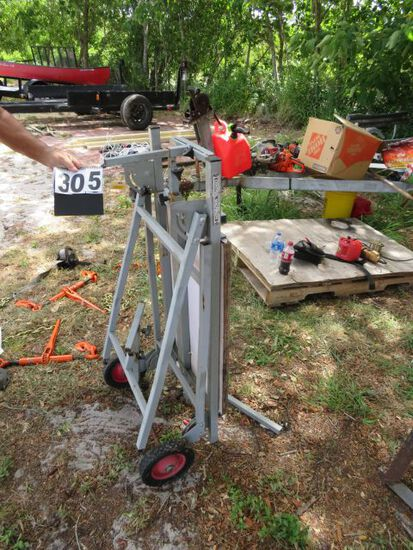 mobile power tool stand by Central Machinery desingned for use with chop or radial saw, jib saw, or