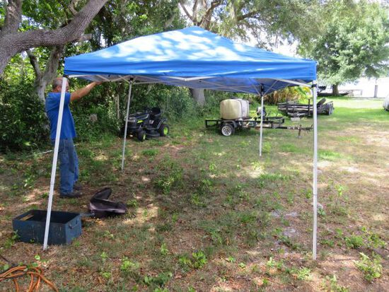 10' x 10' pop up tent with canvas carry bag (like new)