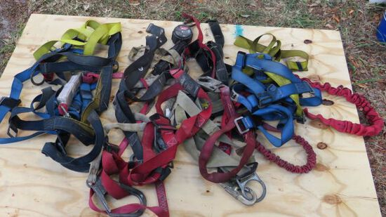 group of safety harnesses including one retractable strap