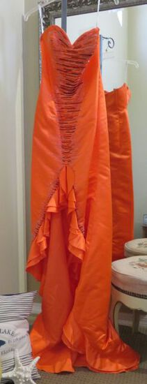 Xcite, size 8, tangerine colored strapless, prom or pageant dress!  Bust 36; Waist 27.5; Hips 39. Ne