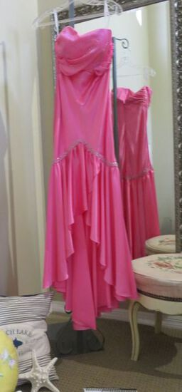 Hot Pink Xtreme strapless prom dress.  This high-low style dress has one loose sequin, easily repair