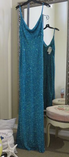 Hand-made turquoise, size 11/12, Scala silk dress with sequins galore.  Perfect for prom or homecomi