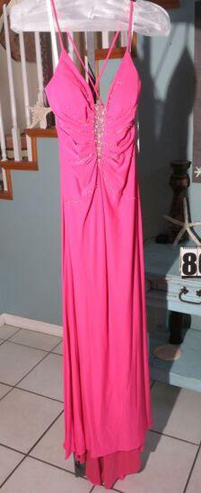 Xcite, size 6,  fuchsia-colored prom dress with spaghetti straps.