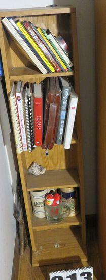 Small book shelf including contents:  Bible Killing Patton, Jesus Life Coach, mugs, etc.