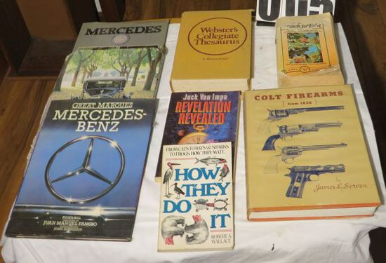Books, including Mercedes Benz, Dictionary and Colt firearms