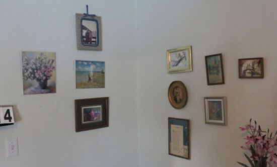 Mixed small wall décor including clock, framed needle point pictures