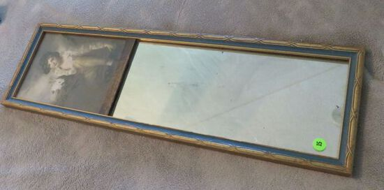 Antique mirror with early print of boy and rabbit