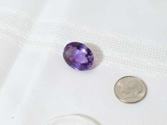 amethyst fancy cut oval shape with flat top and brilliant cut around edges 15.2mm x 20.9mm 20.45ct