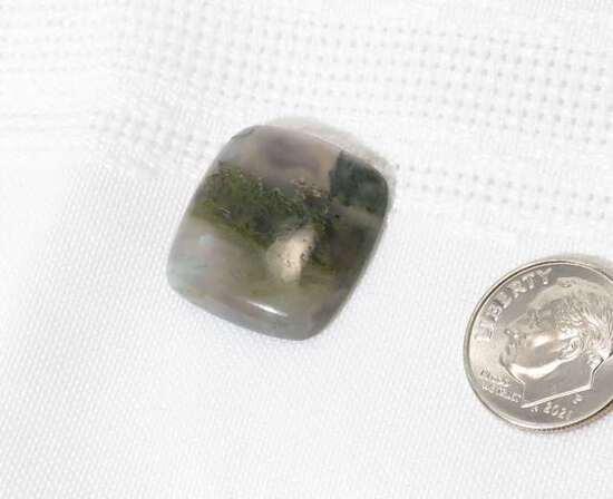 grey clear agaite smooth cushion cut 20.07mm x 21.13mm 5.92mm thick 22.4ct