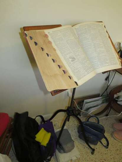 antique metal book stand with large dictionary