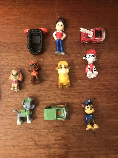 Lot of Paw Patrol figurines and Vehicles