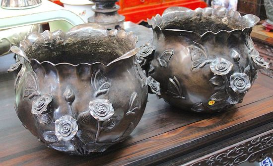 One pair Bronze urns with carved roses