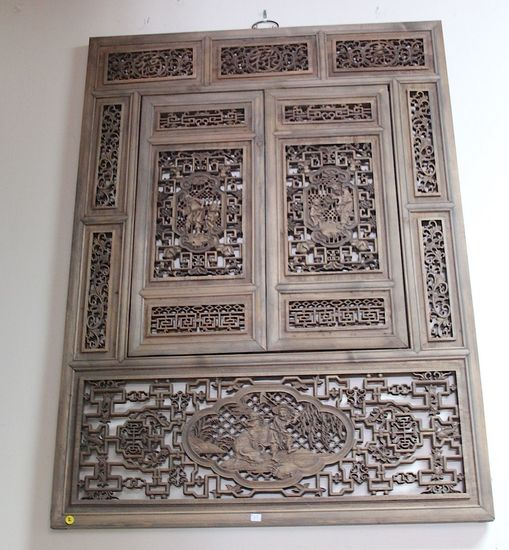 Carved panel with a window, carved symbols of prosperity and peace