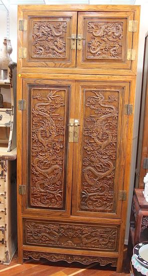 Wooden cabinet with carved dragons motiffs