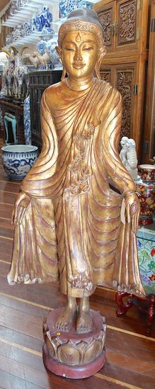 Gold gilted wooden standing Buddha
